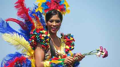 A Colombian woman dressed in colorful costume for a festival